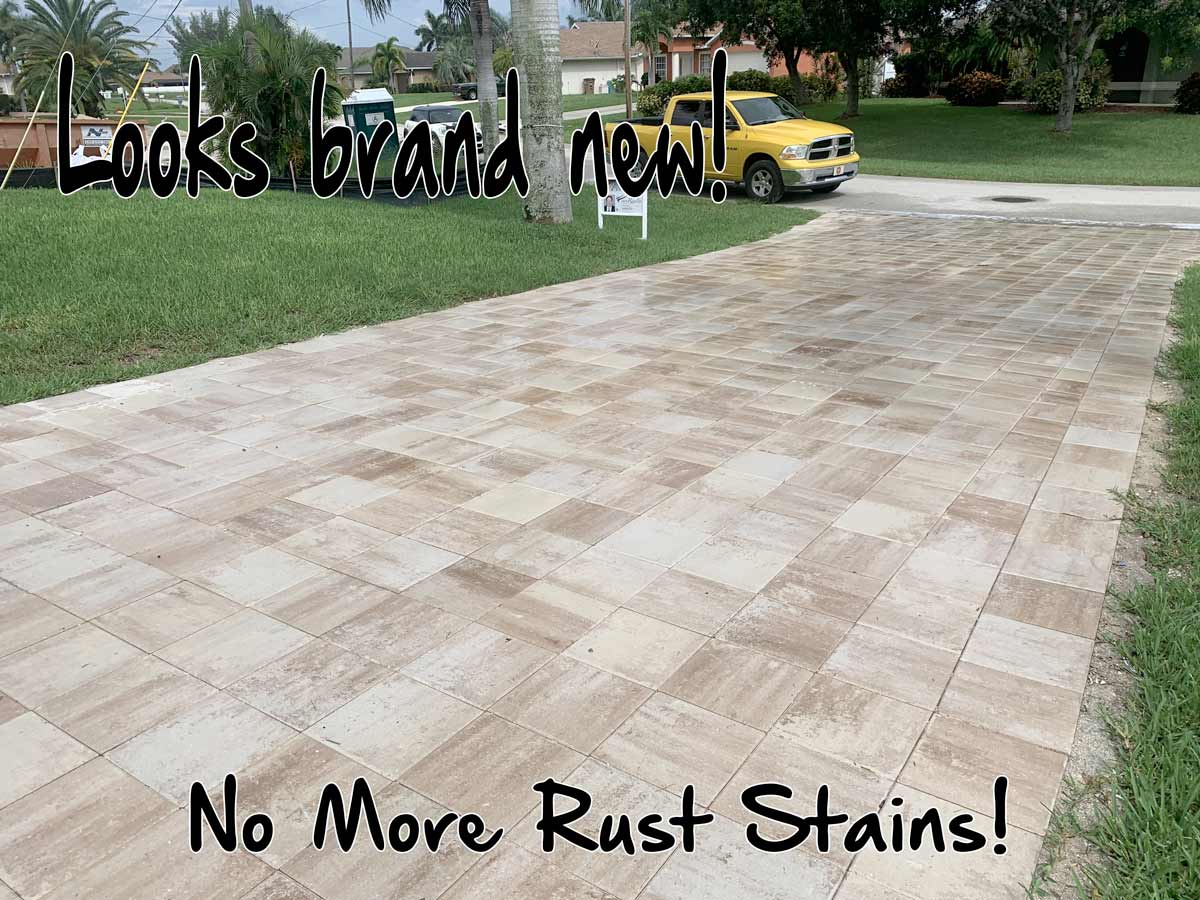 rust stains spots have been removed from the concrete paver driveway